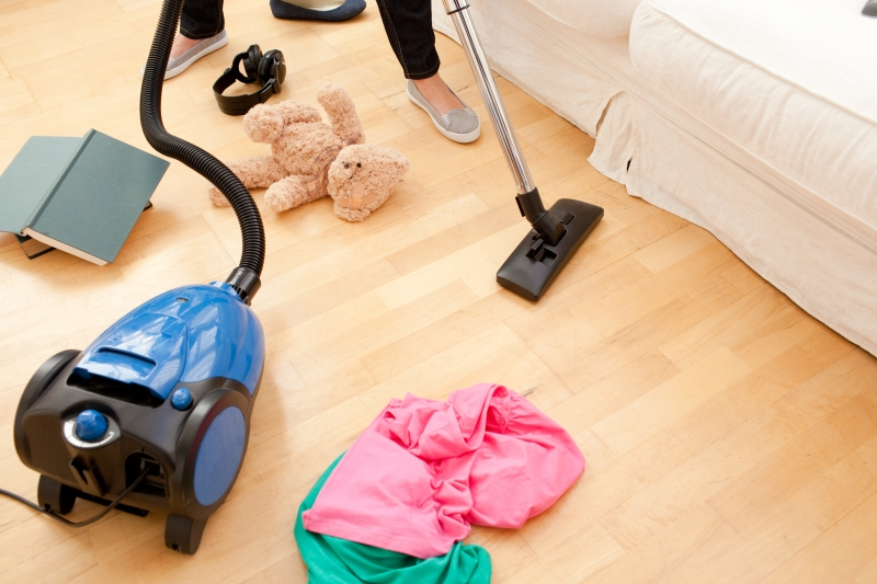 3680993-woman-vacuuming-the-living-room